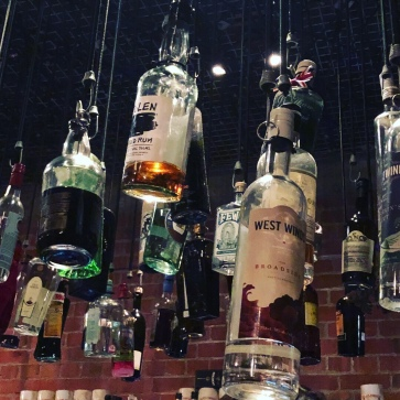 Bottles hanging from the ceiling in Hanging Ditch